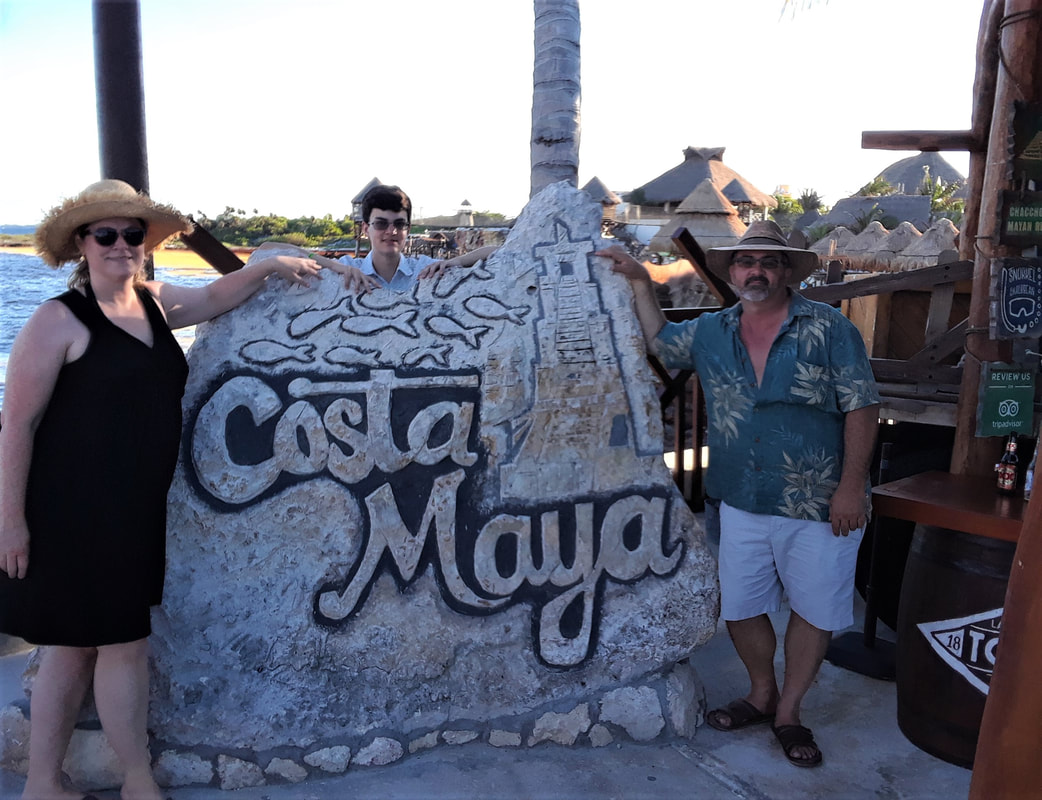 Emily, her husband, and her son in Costa Maya, Mexico.