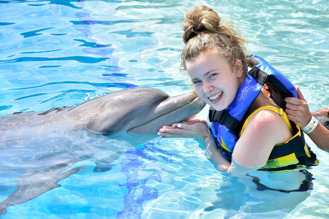Mickey's granddaughter enjoying a Dolphin Encounter excursion while in Mexico