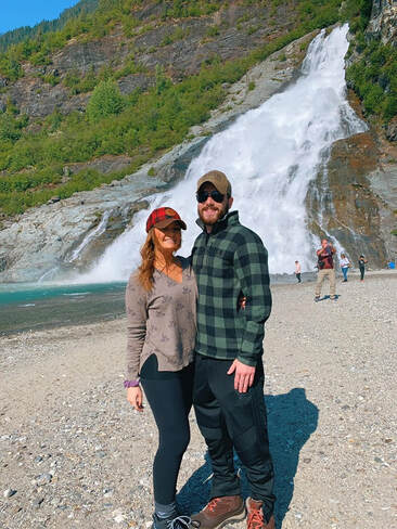Christine and her fiance at Mendenhall Glacier Lake during their stop in Juneau, Alaska.