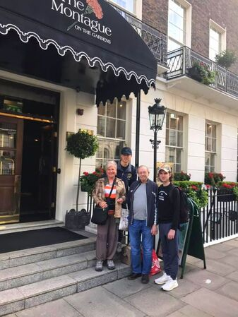 Stephanie, her husband Will, and their two grandsons outside of their hotel in Paris.
