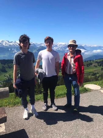 Stephanie's two grandsons with their guide in Switzerland.